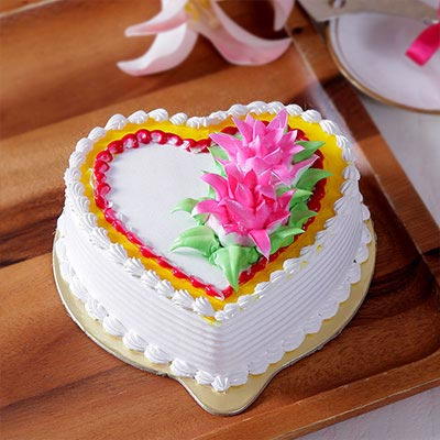 Heart Shaped Pineapple Cake With Cream Flower Toppings Shopnideas