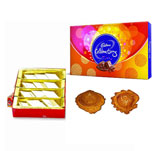 Kaju Katli and Cadbury box with 2 Diyas
