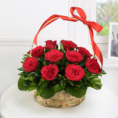 Red Roses in a Round Basket With Handle