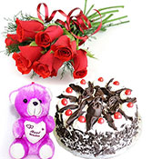 12 red roses with half kg black forest cake with s...