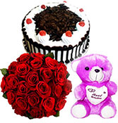 20 red roses with half kg black forest cake with small teddy bear