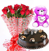 12 red roses with half kg chocolate truffle cake with small teddy bear