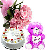 12 pink roses with half kg pineapple cake with small teddy bear